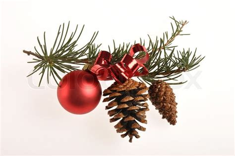 Christmas decoration with pine branch, red glass ball and