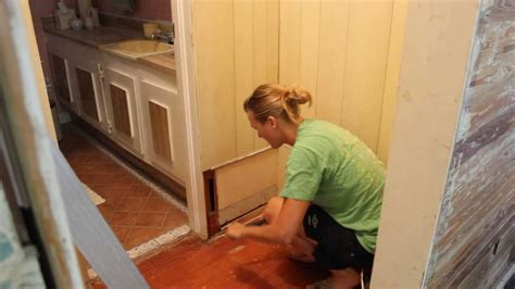using a pry bar to remove paneling and nails - YouTube